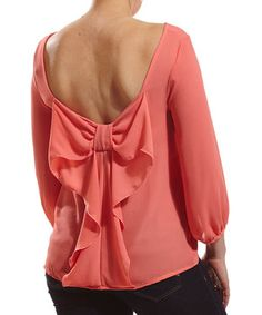 For the lady looking for a unique top to add some pop to her ensemble, choose this bow-back piece. Soft fabric and chic style have never looked better.