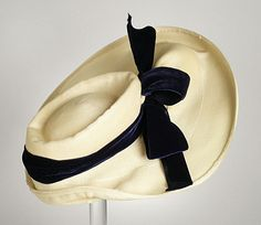 White Milan straw profile hat with silk velvet hat band, by Suzanne Remy, American, c. 1939.