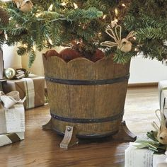 Barrel Planter Christmas Tree Stand. OR you could use an old ice cream maker