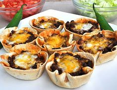 Taco cups- 1 pound ground hamburger Or turkey, 1/2 onion, diced  1 large jalapeno, diced  3/4 cup water  taco seasoning mix (see her site for a recipe!)  12 flour tortillas  2 cups shredded cheese  Shredded lettuce and diced tomatoes for topping.  Prep fillings  Cut tortillas to fit in pan, microwave in paper towel for 30 secs, put in lightly greased muffin tin  350F for 20 minutes