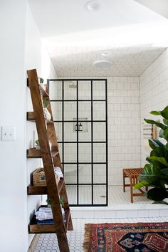 A black steel frame shower panel door in a modern bathroom