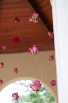 love this idea of stringing flowers to hang from a gazebo