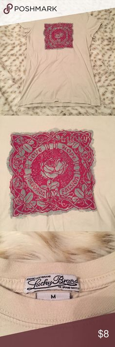 Lucky Brand Cream Graphic T shirt Lucky Brand Graphic t shirt! Size medium! Says love, Hope, devotion, and passion! Used but still in good condition! See pic 4 for pic of only flaw. Small snag. Not noticeable when wearing. Lucky Brand Tops Tees - Short Sleeve