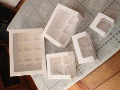 paquete con 5 cajas para cupcakes para 6 cup.