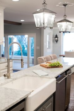 As seen on HGTV's Fixer Upper, French country chandeliers bring character to this lovely white kitchen. French Country Kitchens, Farmhouse Style Kitchen, French Country Decorating, Country French, Farmhouse Ideas, Country Style, Fixer Upper Kitchen, New Kitchen, Kitchen Decor