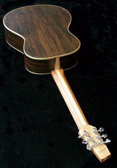 Short multiscale, medium-bodied acoustic in flame redwood and padauk. Ukulele, Acoustic, Guitars, Music Instruments, Medium, Guitar Building, Musical Instruments, Guitar, Vintage Guitars