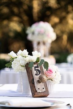 Pin for Later: Disney-Loving Couples Will Melt Over These Magical Wedding Centerpieces Alice in Wonderland