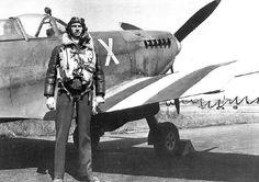 US Navy Pilot with his Spitfire Mk V of VSC7 Used for naval gun spotting June 1944