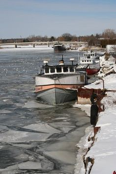 Fishing boats docked in the icy waters of Lake Michigan, Wisconsin.