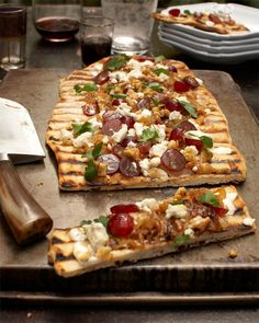 GRILLED FLAT BREAD TOPPED WITH CARAMELIZED ONIONS AND BLUE CHEESE MASCARPONE AND CRUNCHY RED GRAPES