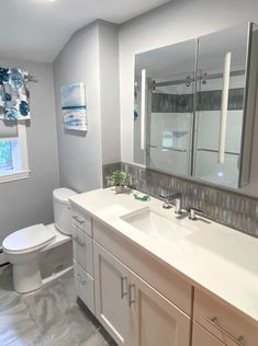 Gray and White Bathroom | McGuire + Co. Kitchen & Bath Wakefield, MA #bathroom #bathroomdesign #bathroomremodeling #bathroomtile Bathroom Gallery, Bathroom Photos, Bathroom Ideas, Gray And White Bathroom, Grey And White, Wakefield, Rain Shower, Shower Doors, Kitchen And Bath