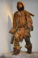 A model wearing the clothing on arctic natives (this is actually the clothing worn by Otzi the Iceman, Late Neolithic European Alps)