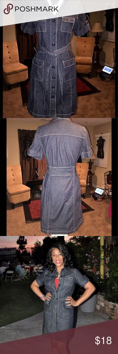 Gloria Vanderbilt button front denim dress First photo is true to color, I used flash on second photo. Safari button front , cuffed short sleeve, front pockets, excellent condition , size 10, just above the knee Gloria Vanderbilt Dresses Midi