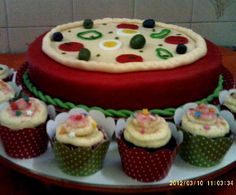 For those who love pizza... A cake pizza and cup cakes