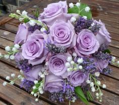 'Ocean Song' roses in bouquet. Imagine touches of green instead of the other purple and white. Yours would be more round with no laterals coming out like the lily of the valley, pictured here.