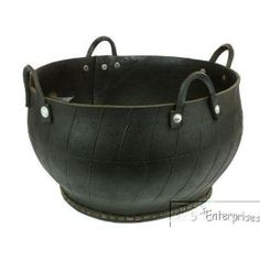 Recycled rubber tire flower pot basket. My dad use to make something similar...blast from d past