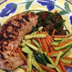 Grilled bourbon peppercorn turkey over spinach w/ bacon and zucchini & carrots.