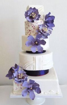 5 tier white and square wedding cake with purple flowers.JPG
