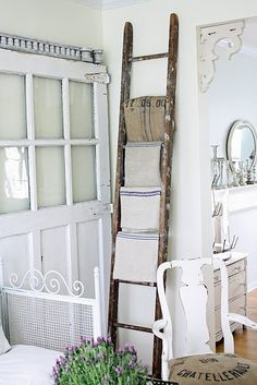 Towel rack ladder.  Maybe out by the pool to hang towels on, I am thinking it is a great idea~