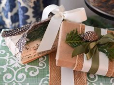"Designer Marian Parsons layers organic elements and textured ribbon to create wrapped gifts that are a step above the rest. Her tips: ""Create pretty packages using items you can find around your house and in nature. Petite pinecones and sprigs of greenery embellish layers of ribbon while vintage sheet music is the perfect custom wrapping for a small gift."""