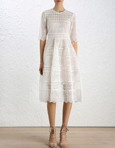 Karmic Embroidered Midi dress, from our Fall 16 collection, in Pearl embroidered organza. Midi length dress with elbow length sleeves and full bell skirt. Scalloped edge on sleeves and skirt hem. Invisible zip closure at shoulders and side seam. Comes with separate silk slip in nude.