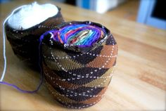 To keep the outside of a centerpull ball from unwinding: Cut a sock to six inches long, and use to cover.