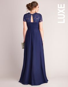 Unavailable sizes will be back in stock 27th of September   100% silk Lace shoulders  Empire waist Subtle stretch panel & keyhole back Side zip for easy dressing    Cause a stir at your next black tie event in the Navy Blue Silk & Lace Maternity Evening Dress. A stunning maternity dress in pure silk, this style drapes beautifully over your curves and cascades to the floor. A comfortable sweetheart bodice gives way to an intricate lace back with chic keyhole detailing designed to revea...