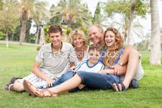 Family posing for camera by get4net - Stock Photo