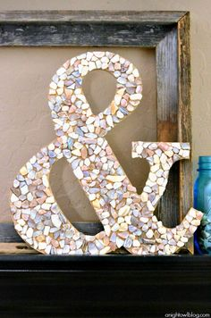Make your own DIY Seashell Ampersand in just a few easy steps! Wouldn't this craft from @anightowlblog be awesome to make after a beach trip?