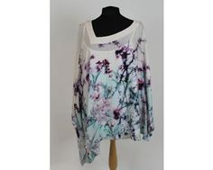 Beautiful satin top with batwing sleeves and open detail on one arm held together with matching colour ribbon. This top comes with its own camisole underneath so no need to buy another item! Top comes in sizes 22 and 24 at www.middeltonwood.co.uk