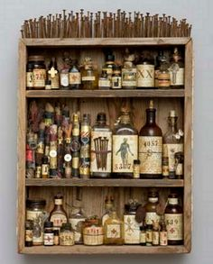 "It's just an art project, but it's still lovely.  ""Medicine Cabinet, Mar Goman.  Wooden box, altered bottles, found objects, scrolls, nails, mixed media, 2009.  24 x 17 x 5"""