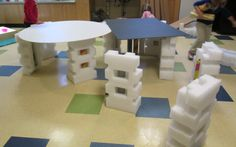 architecture unit-building with big recycled materials such as tubes, styrofoam, and cardboard