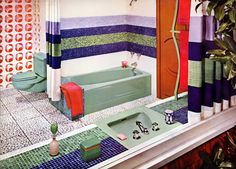 I like how the shower curtain matches the tiles.