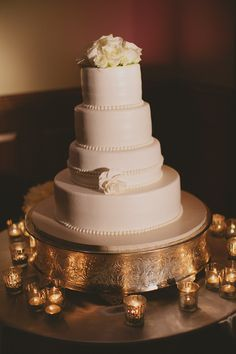 I love this wedding cake!  So simple and elegant with the candles reflecting off of silver base
