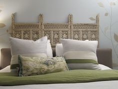 brownstoner.com - love the idea of using a carved screen as a headboard (or propped behind a fabric headboard as this one is)