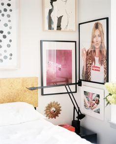 Bedroom Photo - Framed artworks hung beside a burlwood headboard