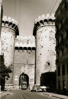 Torres de Quart (Quart Towers) Valencia ~ One of 2 entrances left into the old, walled, town of Valencia; both had moats surrounding them. This photo was probably taken in the 40s-50s. The damage inflicted by the shelling from the Spanish Civil War from 1936-39, is an eery reminder of a very bloody period of modern Spain. My paternal grandparents' place was really close to this towers.