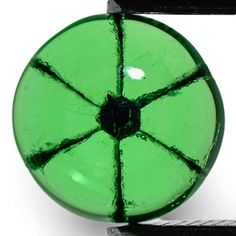 Trapiche Emerald. These things are so cool- they're very rare. Only found in a specific ares in Columbia