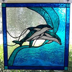 Dolphins jumping stained acrylic glass window by windows2thesoul