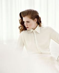 Amy in Norman Jean Roy Photos - amy-adams Photo.  I LOVE this shot.  Fair skin, light background, stark hair and makeup.  Hair part to one side, dress or collared shirt to the neck, hands on the hips.  It's sexy, sassy, and has an edge.  It's the perfect balance.
