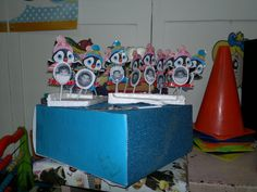 #Preschool #penguins on an iceberg to check attendance   Materials: Coffee removers  Penguin drawings  Childrens Photos Big box Styrofoam  Easy to do no instructions needed