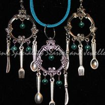 This cutlery set of fork, knife and spoon are highlighted with teal glass pearls on a buttery soft 19 inch teal suede with a handmade clasp.  The cord and clasp are approximately 19 inches long but length can be changed for no extra charge.