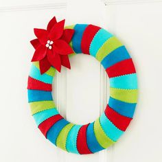 CHRISTMAS FELT DECORATIONS! For cuteness sake! Striped Felt Wreath with Poinsettia Flower.