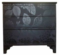 Spray painted dresser - gloss paint stenciled over matte