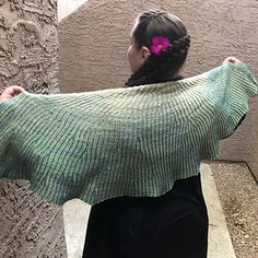 This half-circle shawl features increases branching organically out from the center, and can be knit to any size.