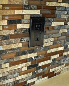 love this tile combo...A stone and glass mosaic backsplash is perfect compliment to the Caesarstone counter and tile floors. The dark outlet trim minimizes its impact visually. The paint colors selected by the clients compliment all of these beautifully--a pleasing and warm combination of colors - See more at: http://www.ventanabuilds.com/SeattleKitchenRemodel.htm#sthash.b6XjufzY.dpufSeattle Kitchen Remodel - Ventana Construction Seattle, Washington