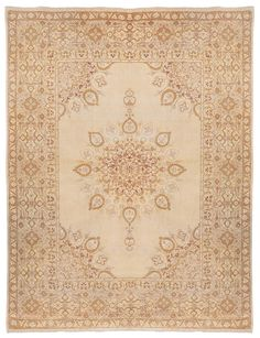 This Amritsar oriental rug's creatively adorned open field is a very seldom found bonus that greatly widens its decorative applications as the anchor of an important room, adding significant depth and movement.
