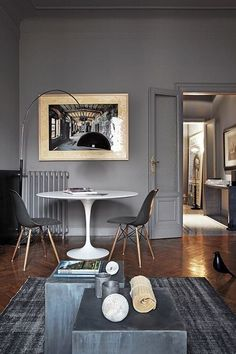 Dark and mysterious - we love it! Get the look with two Eames DSW's and a Tulip Table :-) http://www.nest.co.uk/search/vitra-dsw-eames-plastic-side-chair http://www.nest.co.uk/search/knoll-saarinen-tulip-dining-table-round Image via Designed For Life.