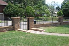 Block retaining wall with black fence - Google Search