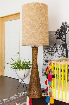 A larger than life floor lamp in baby's eclectic nursery